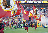 The Washington Redskins flag carriers run onto the field as the team is introduced prior to the NFC Wild Card game against the Green Bay Packers at FedEx Field in Landover, Maryland on Sunday, January 10, 2016.<br /> Credit: Ron Sachs / CNP