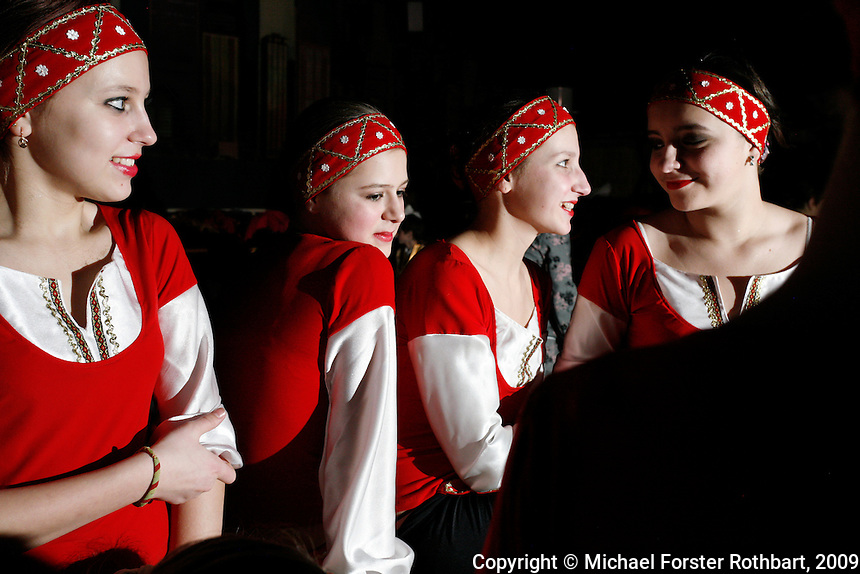 Teenage dancers wait backstage for their turn to perform during a Slavutych city concert. The Chernobyl plant once funded many cultural programs. Now the city struggles with decreased resources due to layoffs at the plant. Mayor Volodymyr Udovychenko blames politics, not the accident, for the area&rsquo;s decline. <br /> ------------------- <br /> This photograph is part the book of Would You Stay?, by Michael Forster Rothbart, published by TED Books in 2013. The photos come from Forster Rothbart&rsquo;s two long-term documentary photography projects, After Chernobyl and After Fukushima.<br /> &copy; Michael Forster Rothbart 2007-2013.<br /> www.afterchernobyl.com<br /> www.mfrphoto.com &bull; 607-267-4893 &bull; 607-436-2856<br /> 34 Spruce St, Oneonta, NY 13820<br /> 86 Three Mile Pond Rd, Vassalboro, ME 04989<br /> info@mfrphoto.com<br /> Photo by: Michael Forster Rothbart<br /> Date:  2/2009    File#:  Canon 5D digital camera frame 54699<br /> -------------------
