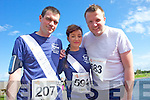 from left Damien Murphy, Tammy Curtin and Tom Boyle pictured at the Rose of Tralee International 10k Race in Tralee on Sunday.