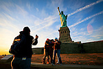 Tourist take pictures at the statue of Liberty monument in New York, 9/01/12. New York City, with a population of over 8.1 million, is the most populous city in the United States. It is known for its status as a financial, cultural, transportation, and manufacturing center, and for its history as a gateway for immigration to the United States.   Photo by Kena Betancur / VIEWpress.