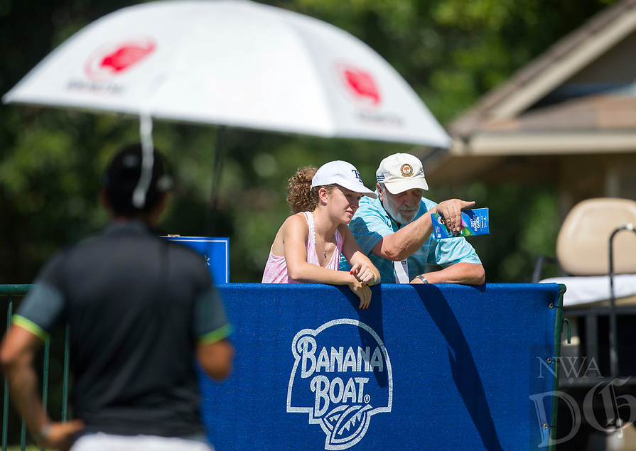 NWA Democrat-Gazette/JASON IVESTER<br /> Sarah Holcomb, 16, and her grandfather Skip Holcomb, both of Rogers, watch players on the practice putting green Wednesday, June 21, 2017, during the Walmart NW Arkansas Championship presented by P&amp;G at the Pinnacle Country Club in Rogers. Pro-am play continues today (THURSDAY).