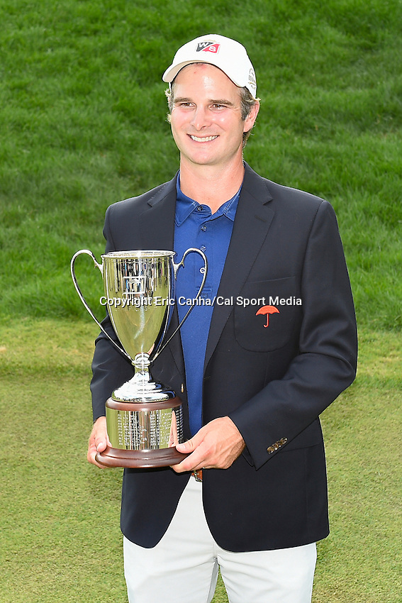 June 22, 2014 - Cromwell, Connecticut - Kevin Streelman holds the championship trophy after winning the PGA Travelers Championship tournament by 1 stroke  at TPC River Highlands in Cromwell, Connecticut.  Eric Canha/CSM