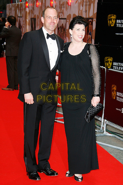 PHIL SPENCER & KIRSTY ALLSOPP.Red Carpet Arrivals for the British Academy Television Awards 2008, held at the London Palladium, London, England, April 20th 2008..BAFTA BAFTA's full length black dress tuxedo suit bow tie sheer sleeves .CAP/DAR.©Darwin/Capital Pictures