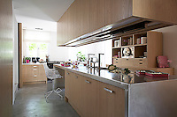 The functional kitchen is built of oak and brushed steel