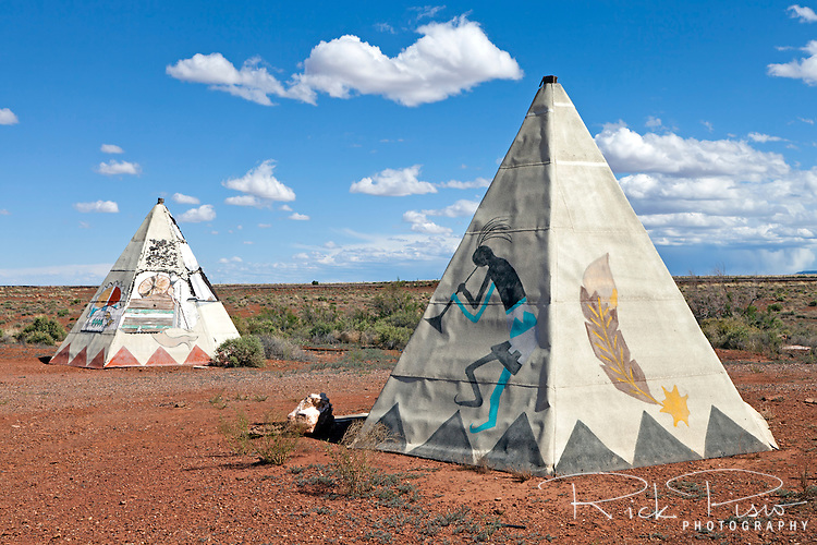 Teepees outside the Meteor City Trading Post along Route 66 west of Winslow, Arizona. The Meteor City Trading Post first opened in 1939 and was known for its geodesic dome, giant roadside dreamcatcher and the world's Longest Map of Route 66. After unsuccesful attempts to sell the business Meteor City closed for good in December of 2012 and is now left for the vandals and the elements.