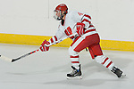 MADISON, WI - SEPTEMBER 29: Mikka Nordby #4 of the Wisconsin Badgers women's hockey shoots the puck against the Quinnipiac Bobcats at the Kohl Center on September 29, 2006 in Madison, Wisconsin. The Badgers beat the Bobcats 3-0. (Photo by David Stluka)