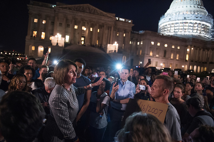UNITED STATES - JUNE 23: House Minority Leader Nancy Pelosi, D-Calif., addresses demonstrators on the East Front of the Capitol who gathered to show solidarity with House Democrats' sit-in on the floor calling on Republicans to allow votes on gun violence legislation, June 23, 2016. (Photo By Tom Williams/CQ Roll Call)