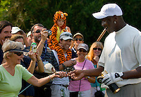 NBA legend Michael Jordan accepts a cigar from a fan while playing a practice round with Tiger Woods during the 2007 Wachovia Championships at Quail Hollow Country Club in Charlotte, NC.