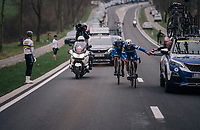 race leaders Niki Terpstra (NED/Quick-Step Floors) & Yves Lampaert (BEL/Quick Step Floors) getting some last (sticky) supplies from the team car for the finale <br /> <br /> 61th E3 Harelbeke (1.UWT)<br /> Harelbeke - Harelbeke (206km)