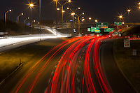 Night-time car light streaks paint the Mopac (Loop 1) Highway 183 Research interchange flyover in North Austin, Texas.