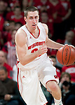 Wisconsin Badgers guard Josh Gasser (21) handles the ball during a Big Ten Conference NCAA college basketball game against the Illinois Fighting Illini on Sunday, March 4, 2012 in Madison, Wisconsin. The Badgers won 70-56. (Photo by David Stluka)