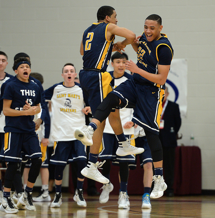 (Springfield, MA, 03/19/16) St. Mary's teammates Jonathan Mercado, left, and Jonathan Mola celebrate during the fourth quarter of the Boys Division 4 state basketball final against Maynard at Springfield College on Saturday, March 19, 2016. Staff photo by Christopher Evans