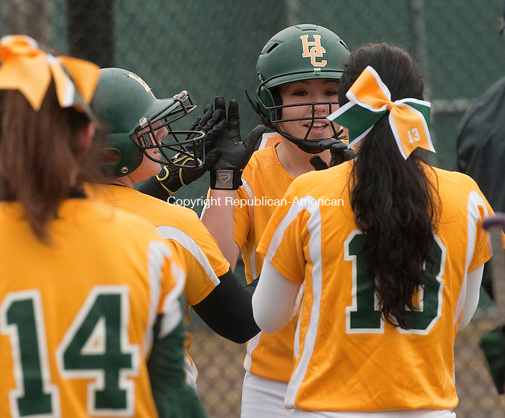 WATERBURY,  CT,  CT-041015JS08- Holy Cross' Elizabeth Lombardo (20) is congratulated by teammates after coming in to core during their 20-0 win over Kennedy Friday at Municipal Stadium in Waterbury.  <br /> Jim Shannon Republican-American