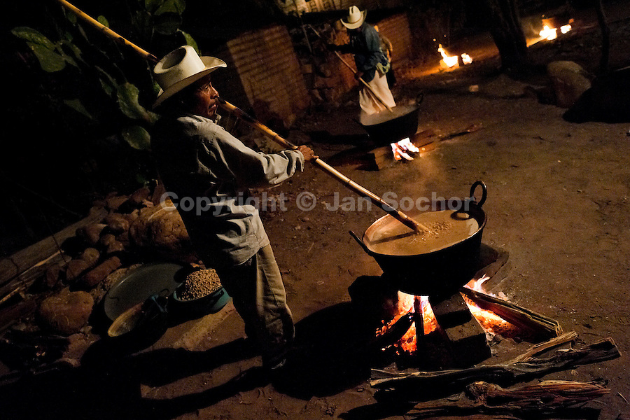 "A Cora Indian man stirs beans in a big pot on the open fire during the sacred ritual ceremony of Semana Santa (Holy Week) in Jesús María, Nayarit, Mexico, 21 April 2011. The annual week-long Easter festivity (called ""La Judea""), performed in the rugged mountain country of Sierra del Nayar, merges indigenous tradition (agricultural cycle and the regeneration of life worshipping) and animistic beliefs with the Christian dogma. Each year in the spring, the Cora villages are taken over by hundreds of wildly running men. Painted all over their semi-naked bodies, fighting ritual battles with wooden swords and dancing crazily, they perform demons (the evil) that metaphorically chase Jesus Christ, kill him, but finally fail due to his resurrection. La Judea, the Holy Week sacred spectacle, represents the most truthful expression of the Coras' culture, religiosity and identity."