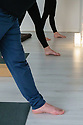 London, UK. 13.02.2019. Julia Moore leads her yoga students in a class at Yoga One London, Hornsey. Photograph © Jane Hobson.