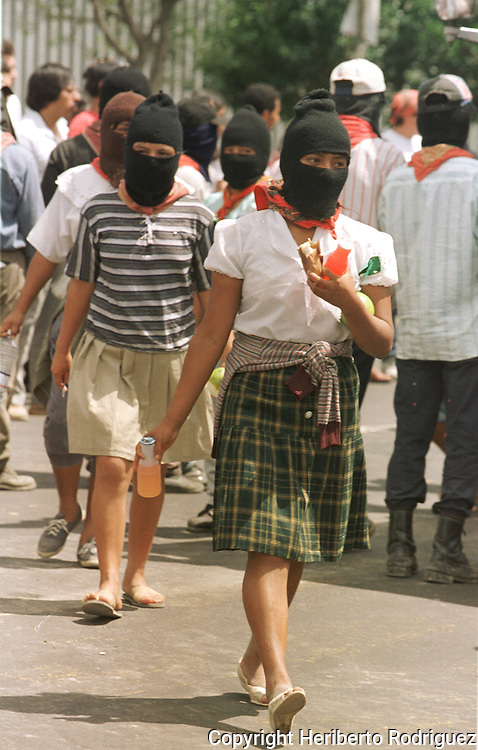 Zapatista Indian women queue during a demonstration on Mexico City main streets, September 13, 1997. 1,111 Zapatista peasants spread out all over Mexico demanding for their rights after leaving their stronghold in Chiapas. Photo by Heriberto Rodriguez