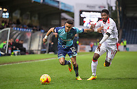 Paris Cowan-Hall of Wycombe Wanderers holds off Andre Blackman of Crawley Town during the Sky Bet League 2 match between Wycombe Wanderers and Crawley Town at Adams Park, High Wycombe, England on 25 February 2017. Photo by Andy Rowland / PRiME Media Images.