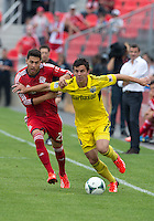 July 27, 2013: Toronto FC midfielder Jonathan Osorio #21 and Columbus Crew midfielder Bernardo Anor #7 in action during an MLS regular season game between the Columbus Crew and Toronto FC at BMO Field in Toronto, Ontario Canada.