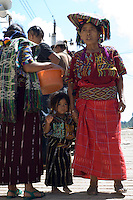 A woman and her small daughter, both dressed in traditional Chajul clothes, in the market.
