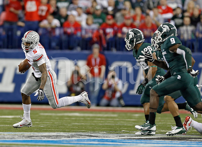 Ohio State Buckeyes quarterback Braxton Miller (5) takes off running against Michigan State Spartans in the 2nd quarter during the Big 10 Championship game at Lucas Oil Stadium in Indianapolis, Ind on December 7, 2013.  (Dispatch photo by Kyle Robertson)
