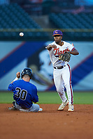 Jimmy Herron (30) of the Duke Blue Devils slides into second base while Jordan Greene (9) of the Clemson Tigers makes a throw to first base in Game Three of the 2017 ACC Baseball Championship at Louisville Slugger Field on May 23, 2017 in Louisville, Kentucky. The Blue Devils defeated the Tigers 6-3. (Brian Westerholt/Four Seam Images)
