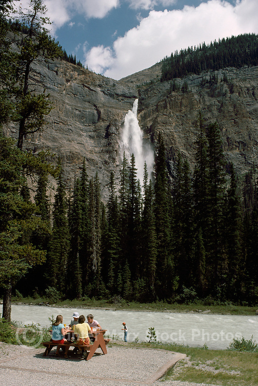 Yoho National Park, Canadian Rockies, BC, British Columbia, Canada - People having Picnic beside Yoho River at Base of Takakkaw Falls, Summer