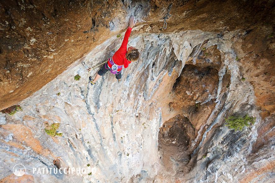 A female sport climber on Skyline, 7c, at Geyikbayiri, Turkey