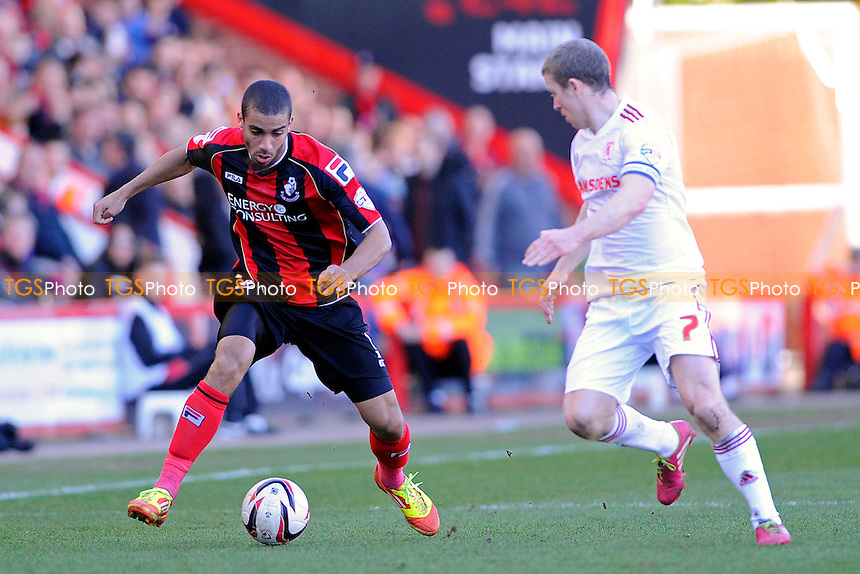 Lewis Grabban of AFC Bournemouth takes on Grant Leadbitter of Middlesbrough - AFC Bournemouth vs Middlesbrough - Sky Bet Championship Football at the Goldsands Stadium, Bournemouth, Dorset - 15/03/14 - MANDATORY CREDIT: Denis Murphy/TGSPHOTO - Self billing applies where appropriate - 0845 094 6026 - contact@tgsphoto.co.uk - NO UNPAID USE