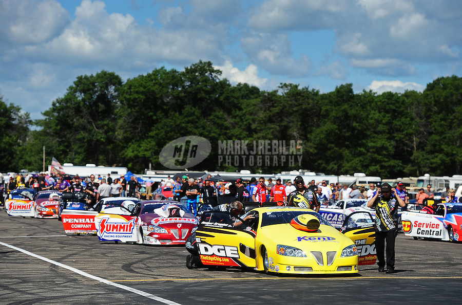 Aug. 21, 2011; Brainerd, MN, USA: NHRA pro stock driver Rodger Brogdon (right) waits in the staging lanes to race during the Lucas Oil Nationals at Brainerd International Raceway. Mandatory Credit: Mark J. Rebilas-