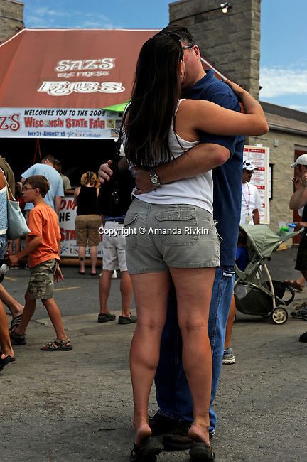 A couple kissing at the Wisconsin State Fair in West Allis, Wisconsin on August 3, 2008.