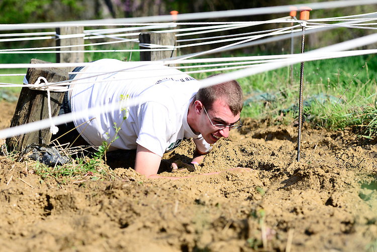 Participants of the Mud Run trudge through the mud during Ohio Health O'Bleness Hospital Race for a Reason which took place on Saturday morning, April 26, 2014. Photo by Olivia Wallace