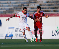 Mike Callahan (5) of the Richmond Kickers fights for the ball with Dwayne De Rosario (7) of D.C. United during a third round match in the US Open Cup at City Stadium in Richmond, VA.  D.C. United advanced on penalty kicks after tying the Richmond Kickers, 0-0.