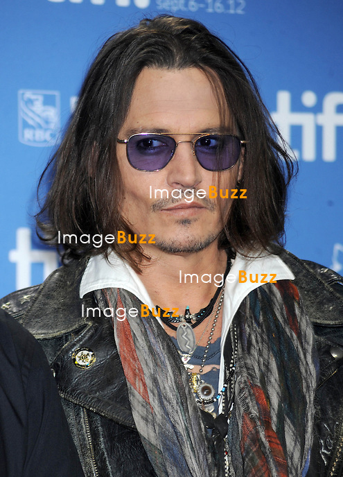 "JOHNNY DEPP AT THE TORONTO FILM FESTIVAL - Johnny Depp has stayed pretty low key since his split with longtime partner Vanessa Paradis, but he came to the Toronto International Film Festival on Saturday September 9, wearing his usual scarves and bracelets and a pair of blue-tinted sunglasses, to talk about something close to his heart: the documentary "" West of Memphis ""..Canada, Toronto, September 6, 2012."