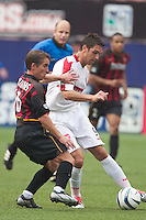 Richie Willams of the MetroStars defends against Ante Razov of the Fire who scored two goals. The Chicago Fire defeated the NY/NJ MetroStars 3-2 on 6/14/03 at Giant's Stadium, NJ..