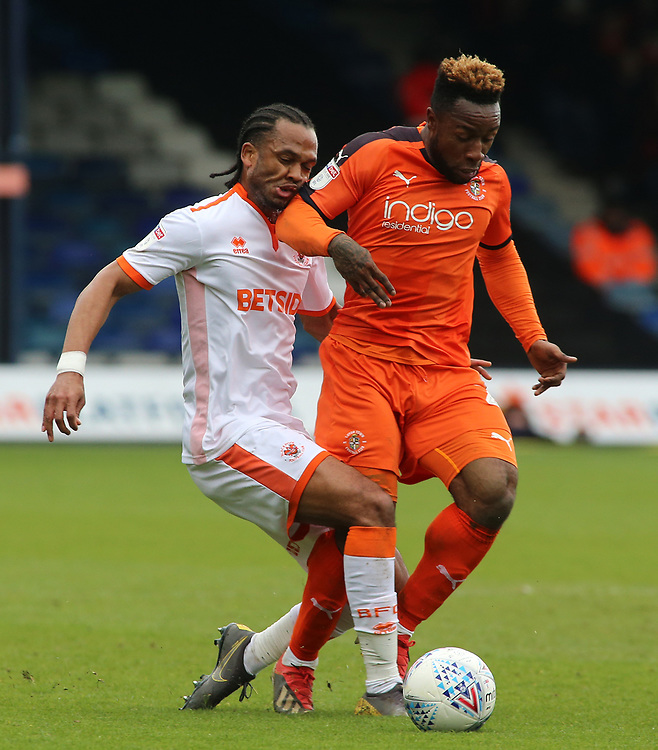 Blackpool's Nathan Delfouneso battles with Luton Town's James Justin<br /> <br /> Photographer David Shipman/CameraSport<br /> <br /> The EFL Sky Bet League One - Luton Town v Blackpool - Saturday 6th April 2019 - Kenilworth Road - Luton<br /> <br /> World Copyright © 2019 CameraSport. All rights reserved. 43 Linden Ave. Countesthorpe. Leicester. England. LE8 5PG - Tel: +44 (0) 116 277 4147 - admin@camerasport.com - www.camerasport.com
