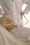 elder woman in hospital with oxygen supply