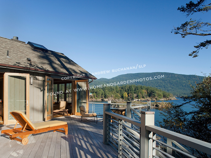 An expansive deck offers a beautiful water view on a sunny day. this image is available through an alternate architectural stock image agency, Collinstock located here: http://www.collinstock.com
