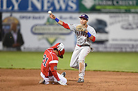 Auburn Doubledays second baseman Bryan Mejia (1) attempts to turn a double play as Rony Cabrera (21) slides in during a game against the Batavia Muckdogs on June 14, 2014 at Dwyer Stadium in Batavia, New York.  Batavia defeated Auburn 7-2.  (Mike Janes/Four Seam Images)