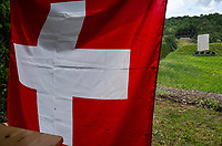 """Switzerland. Canton Ticino. Cureglia is a municipality in the district of Lugano. """"Tiratori del Gaggio"""" society. View from the shooting range to the targets distants 300 meters. Swiss flag. The flag of Switzerland displays a white cross in the centre of a square red field. The white cross is known as the Swiss cross.  25.05.2019 © 2019 Didier Ruef"""