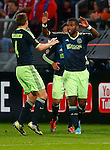 Nederland, Utrecht, 26 september  2012.Seizoen 2012-2013.KNVB Beker.FC Utrecht-Ajax.Ryan Babel (r.) van Ajax juicht nadat hij de 0-2 heeft gescoord. Niklas Moisander (l.) van Ajax feliciteert hem.