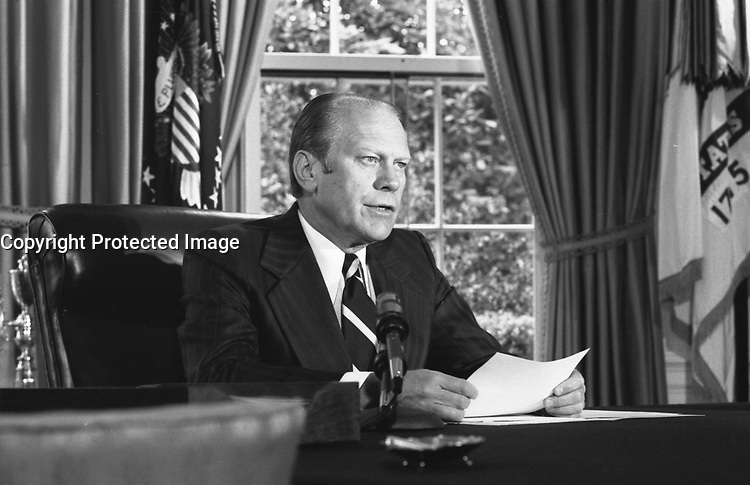 President Ford announces his decision to pardon Nixon, September 8, 1974, in the Oval Office.<br /> <br /> PHOTO :  David Hume Kennerly