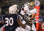 Nevada defender L.J. Jackson (10) hits UC Davis' Nolan Tooley (84) in the endzone during the second half of an NCAA college football game in Reno, Nev. on Thursday, Sept. 3, 2015. Nevada won 31-17. (AP Photo/Cathleen Allison)