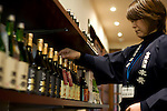 Photo shows Suehiro Sake Brewery in Aizu-wakamatsu City, Fukushima, Japan on 15 March 2013.  Photographer: Robert GilhoolyA staffer arranges bottles of sake on sale at the Suehiro Sake Brewery in Aizu-wakamatsu City, Fukushima, Japan on 15 March 2013.  Photographer: Robert Gilhooly