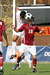 11 November 2008: NC State's Romulo Manzano (VEN) (15) heads the ball over Virginia Tech's Hunter Cheatham (16). North Carolina State University Wolfpack defeated the Virginia Tech Hokies 3-1 at Koka Booth Stadium at WakeMed Soccer Park in Cary, NC in a men's ACC tournament first round game.