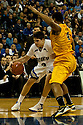 18 February 2012: Doug McDermott #3 of the Creighton Bluejays drives around Eugene Phelps of the Long Beach State 49ers during the second half at the CenturyLink Center in Omaha, Nebraska. Creighton defeated Long Beach State 81 to 79.
