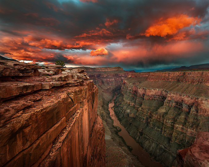 The afterglow of the setting sun illuminates the Colorado River under Toroweap, a remote location in the Grand Canyon.<br />
