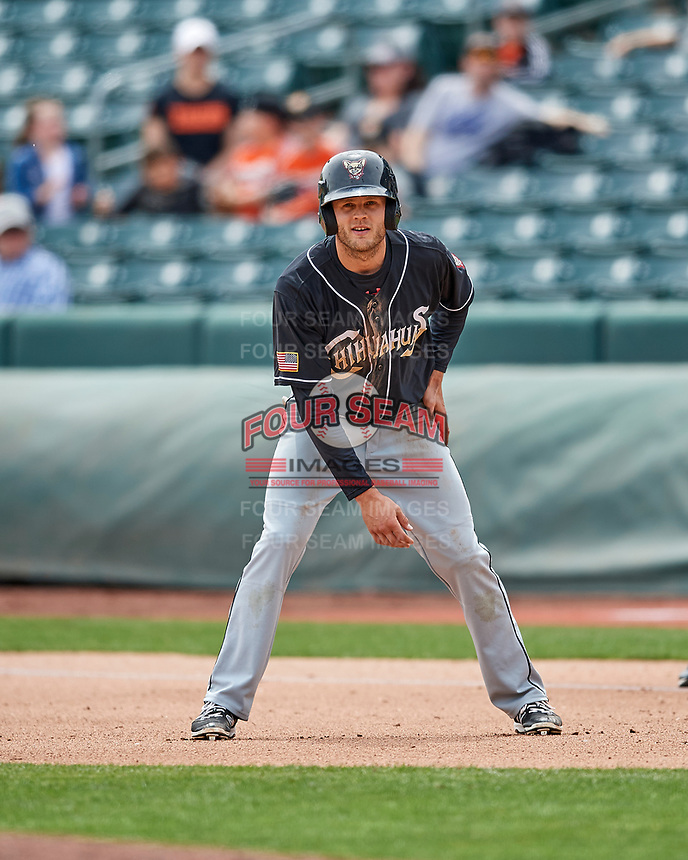 Nick Buss (11) of the El Paso Chihuahuas takes his lead during the game against the Salt Lake Bees in Pacific Coast League action at Smith's Ballpark on April 30, 2017 in Salt Lake City, Utah. El Paso defeated Salt Lake 3-0. This was Game 1 of a double-header.  (Stephen Smith/Four Seam Images)