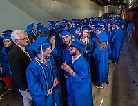 NWA Democrat-Gazette/ANTHONY REYES @NWATONYR<br />Angus Floyd, (from left) Austin Hughes and Mcarter Murr (CQUED) and Danielle Clark wait to walk out on the floor Friday, May 19, 2017 for the  Rogers High School graduation at Bud Walton Arena in Fayetteville.