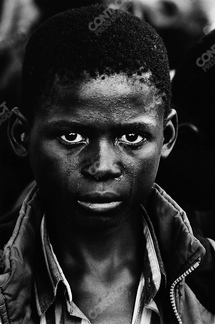 A boy at the funeral of his father who died of AIDS, Ndola, Kawama cemetery, Zambia, 2000.
