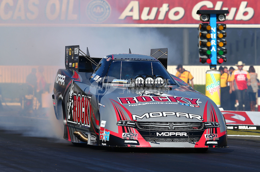 Feb 8, 2015; Pomona, CA, USA; NHRA funny car driver Matt Hagan during the Winternationals at Auto Club Raceway at Pomona. Mandatory Credit: Mark J. Rebilas-